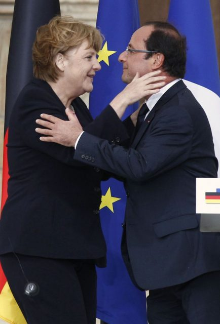 France's President Hollande and German Chancellor Merkel kiss each other after their speeches during the 50th anniversary ceremony of a reconciliation meeting in Reims